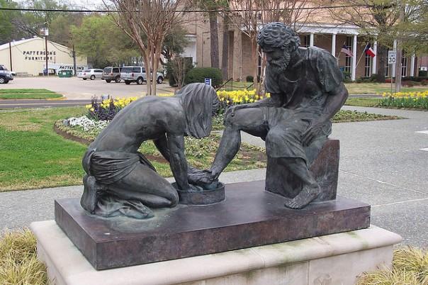 Jesus Washing Peter's Feet Sculpture beside the Prayer Tower, Pittsburg, Texas.   Inscription: Divine Servant Jesus Christ Washing Peter's Feet